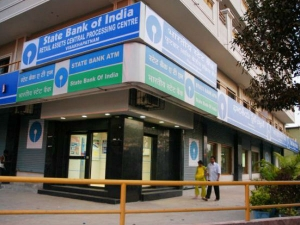 Sbi Q4 Results Biggest Ever Quarterly Loss At Rs 7 718 Crore