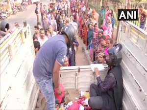 Bihar Cooperative Workers Wearing Helmets To Sell Onions